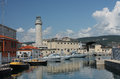 Lighthouse, motor boats  in harbor in Trieste, Italy Royalty Free Stock Photo