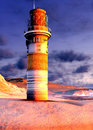 Lighthouse by the ocean at sunset Stock Photos