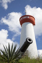 Lighthouse and old cannon on top of Gustavia Harbor,  St Barts, French West Indies Royalty Free Stock Photo
