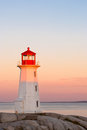 Lighthouse peggys cove at sunrise Stock Photography