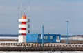 Lighthouse in pirita yacht harbor at winter tallinn estonia Royalty Free Stock Photo