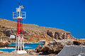 Lighthouse in the port of chora sfakion little striped crete greece Royalty Free Stock Photos