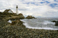 Lighthouse protects during storm portland head mariners as a approaches Stock Images
