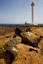 Lighthouse and rock in the blue sky   anzarote spain Stock Images