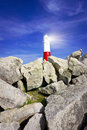 Lighthouse on rocks with light beams Royalty Free Stock Photography