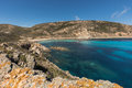 Lighthouse and rocky coastline at Revellata in Corsica Royalty Free Stock Photo