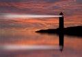 Lighthouse searchlight beam through marine air at night. Royalty Free Stock Photo
