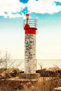 Lighthouse on stoney beach at lake ontario Stock Photography