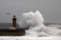 Lighthouse storm at the entry of douro river harbor Stock Photos