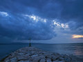 Lighthouse in storm at a stones between adriatic sea and river cetina omis croatia dalmatia horizontal color photo Stock Photography
