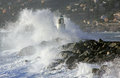 Lighthouse in the storm white hit by a big wave Royalty Free Stock Photo
