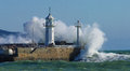 Lighthouse and strong sea gale Royalty Free Stock Images