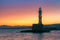 Lighthouse at sunrise chania crete greece in old harbour of Royalty Free Stock Photo