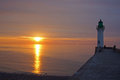 Lighthouse at sunset in st vallery en caux Royalty Free Stock Photo