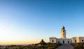 Lighthouse at sunset traditional showing sea in background Royalty Free Stock Photo