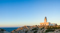 Lighthouse at sunset traditional showing sea in background Stock Image