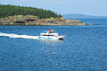Lighthouse tours boat in acadia national park bar harbor maine july at the frenchman bay on july reserves Royalty Free Stock Photos