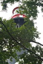 Lighthouse in the trees Royalty Free Stock Photo