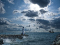 Lighthouse under storm ships background Royalty Free Stock Images