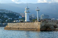 Lighthouse white on the pier in the city of yalta republic of crimea russia Royalty Free Stock Images
