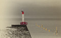 Lighthouse in the winter fog an unmanned early morning that has been colourized Royalty Free Stock Photos