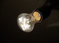 Lighting bulb in the dark Royalty Free Stock Image