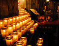 Lighting a candle in church notre dam cathedral Royalty Free Stock Image