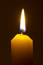 Lighting candle macro of burning isolated on black background Stock Image