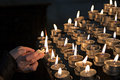 Lighting candles in a church Royalty Free Stock Photo