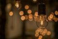 Lighting decor. Retro light bulb filament close up.Illuminated. Royalty Free Stock Photo