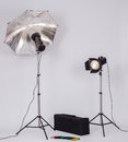 Lighting equipments with umbrella and spotlight Stock Image