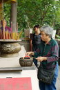 Lighting incense stick, A-Ma Temple, Macau. Royalty Free Stock Image