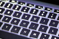 Lighting keyboard qwerty with background light Royalty Free Stock Photos