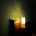 Lighting naturmort zigzag tube with red wood and stoned wall in a dark room Stock Photography