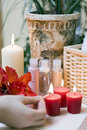 Lighting a spa candle Royalty Free Stock Image