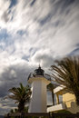 Lighting tower in Costa Brava, village Palamos Spain with long Royalty Free Stock Photo