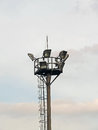 Lighting tower with spotlight a metallic ladder and a lightning rod Stock Photo