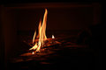 Lighting up the chimney fire with chipped woods Stock Photography