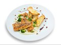 Lightly fried salmon with herb sauce broccoli and baked baguettes Royalty Free Stock Photos