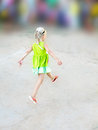 Lightness of being the running little girl in a flavovirent sundress Royalty Free Stock Photography