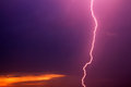 Lightning against dark cloudy sky Stock Photography