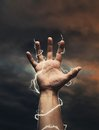Lightning around men's hand Royalty Free Stock Photo