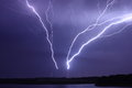 Lightning bolts striking antennas from strong storm a set of broadcast transmission Royalty Free Stock Photography