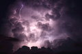 Lightning cloud background multiple bolts strike through a towering storm Stock Photos