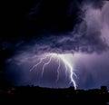 Lightning in the night sky above city Stock Photo