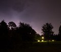Lightning over a ranch strike in the distance small house Royalty Free Stock Images