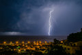 Lightning over the sea night scene Stock Photos