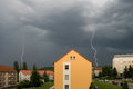 Lightning over urban houses Royalty Free Stock Images
