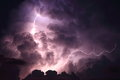 Lightning storm cloud bolt strikes through a towering Royalty Free Stock Photography