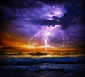 Lightning and storm on sea to the sunset Royalty Free Stock Photo